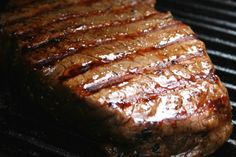 Marinated London Broil. 1/4 cup soy sauce, 1/2 cup dark brown sugar, 2 TBSP olive oil, 3 cloves garlic, minced or crushed, 1/2 tsp ground ginger 1 1/2 to 2 1/4-pound piece of London Broil. Marinade overnight. Broil or Grill to med rare.