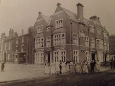 A group of workmen, possibly floorlayers, outside the newly completed Pack Horse Hotel, Bradshawgate 1904.