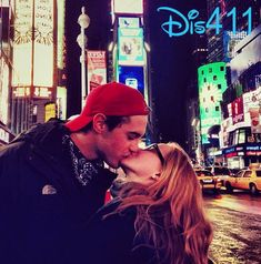 They kiss in the middle of Times Square (romantic much?!)   Community Post: 16 Reasons Why Dove Cameron And Ryan McCartan Are The Most Perfect Couple