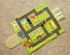 Toy Car Play Mat Wallet.  No tutorial but there is a link to the fabric on Spoonflower.  Also, this site has other good tutorials.