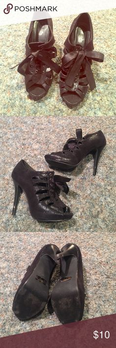 Lace up heels Really cute lace up heels! Black shimmering color. Heel is 5 inches. Really comfy. Gently used, there is a mark on the right heel (pictured). Charlotte Russe Shoes Heels