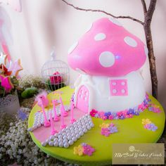 Adorable flower trimmed mushroom house cake at a Fairy Woodland Party #fairywoodland #partycake
