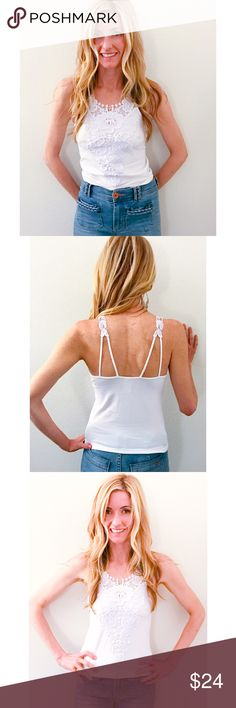 Crocheted Lace Cami The perfect cami embellished with crochet lace detail. Double strap feature for a unique look. Pair with all sorts of looks or pair with your favorite jeans or shorts for a casual look. Made of poly/spandex blend. Super stretchy. Size OSFM colors white or Peach Threads & Trends Tops Camisoles