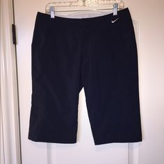 "Nike quick dry performance shorts Nike performance capris. Drawstring adjustable waistband. Hook closures. Navy blue. 14"" inseam. Hit right at or below the knee depending upon how tall you are. Like new. Nike Pants"