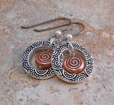 Just for fun! The copper swirl center adds a nice pop of color to the silver decorative circle in these great for everyday wear dangle earrings.  by ByEJewelry.  E-304/ $16.00
