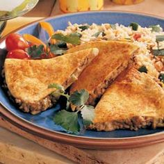 Beef Quesadillas Recipe -Quick-cooking ground beef is the perfect ingredient for on-the-run cooks. Try serving these quesadillas with your favorite taco toppings, such as sour cream, salsa, guacamole, chopped tomatoes, shredded lettuce and sliced olives.