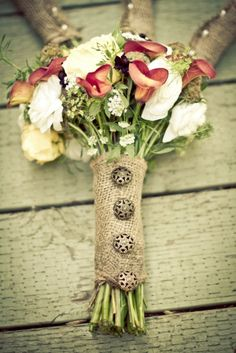 For a rustic wedding, a burlap bouquet wrap with tarnished metal buttons is the perfect finishing touch.