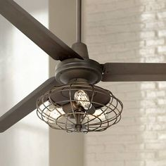 Enjoy a powerful refreshing breeze with this industrial cage style ceiling fan featuring Nostalgic Edison style bulbs. Style # at Lamps Plus. Rustic Chandelier, Rustic Lighting, Farmhouse Style Ceiling Fan, Cage Light, Bronze Ceiling Fan, Mason Jar Lighting, Lamp Design, Industrial Style, Ceiling Fans
