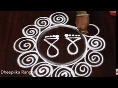 Rangoli is an artistic creation with rice flour that is made outside the front entrance of the house It is usually done by the women folk of the house early . Rangoli Designs Flower, Rangoli Patterns, Beautiful Rangoli Designs, Kolam Designs, Alpona Design, Colored Rice, Fairs And Festivals, Goddess Lakshmi, Simple Rangoli