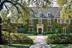 Architect Peter Marino updated this 1920s Dallas mansion and left much of the exterior intact but installed a limestone front door surround | archdigest.com