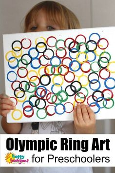 Easy Olympic Craft for Kids - Toddlers and Preschoolers can stamp up a piece of Olympic Ring Art to hang in the playroom or the classroom in honour of the Summer or Winter Olympic games - Happy Hooligans