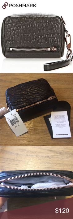 NWT 💯% Authentic Alexander Wang wallet / wristlet LARGE FUMO IN PEBBLED BLACK WITH ROSE GOLD Online at alexanderwang.com for $225.00 DETAILS: LARGE FUMO CLUTCH SIZE ZIPPED CONTINENTAL WALLET WITH TWO EXTERIOR ZIPPED MONEY POCKETS AND THINK WRISTLET STRAP. THE INTERIOR HAS TWELVE CREDIT CARD AND THREE PAPER ORGANIZING POCKETS. 100% LAMBSKIN MEASURES: 16.5 CM X 10.5 CM X 3.5 CM IMPORTED. STYLE: 701054 Alexander Wang Bags Clutches & Wristlets