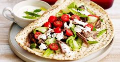Try this tender slow-cooked lamb served on fresh pita bread and drizzled with lemon yoghurt.