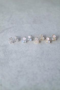 "A cluster of beautiful crystals in a petite setting. Details: - .4"" long - Post back"