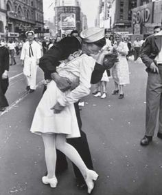 This is one of the most famous photographs from the Second World War. The soldier and the nurse are unknown but people have come forward to claim the fame. Apparently the nurse slapped the soldier immediately after. The event was the celebration of the end of the war and it was taken in Times Square by Alfred Eisenstaedt.