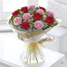 Heavenly Pink and Red Rose Hand-tied. Sending a a bouquet of beautiful roses says it all. And you can relax in the knowledge that your Interflora florist will select the finest, large-headed red and pink roses to create a hand-tied bouquet guaranteed to take their breath away.