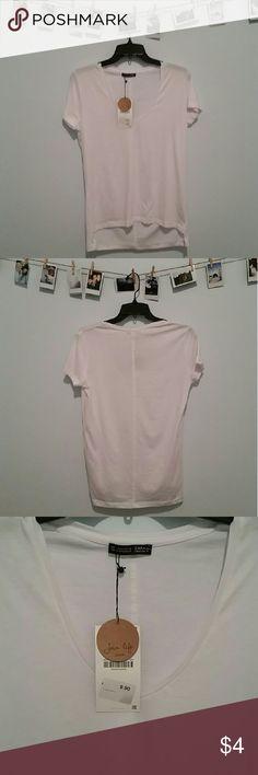 Zara white high low v-neck t-shirt Brand new with tags. Zara white v-neck t-shirt. 100% cotton and machine washable Zara Tops Tees - Short Sleeve