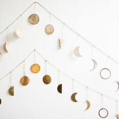 Welcome the magic of the lunar cycle into your home with one (or both!) of these gorgeous moon garlands. Each pendant has a lovely patina that's reminiscent of the real moon's natural shadows. Makes a