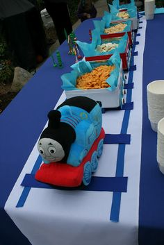 Snack train for birthday party - a great way to serve food! Cute idea for a boys party.