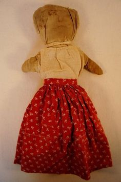 A real rag doll with sugar bag dress, early primitive