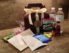 Welcome Box Contents for Guests:  Charleston Tea Plantation Tea, Firefly Sweet Tea Vodka, Charleston Chews, South Carolina Peanuts, Granola Bars, Chocolate Truffles and Water, plus welcome letter and custom map featuring event locations for the wedding weekend.