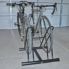 2-in-1 Bike Rack by GINO DEVELOPMENT. $29.99. The quickest and most convenient way to store your bikes upright! Just slide it in & go! Tired of bikes lying all over the garage floor and yard because they don't have kickstands or the kids don't want to put them away? This 2-in-1 bike stand is a great way to store them upright - & kids love it so much, they'll actually look forward to using it! It's designed from strong steel tubing for stability and has protective ...