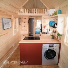 Tiny Home with staircase storage (no ladder, thankfully), washer/dryer combo, and bedroom on the first floor.