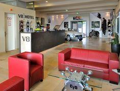 V8 Hotel Lobby Area Red Sofas
