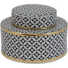 Perfect displayed on the living room etagere or grouped in a chic vignette, this decorative ceramic jar features a geometric design and black and gold finish.
