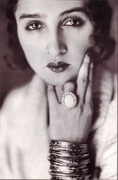 Jacques Henri Lartigue - Reneé Perle, ca. 1930. I've always loved this photo..the lips-the bangles...