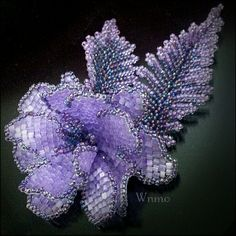 Purple beaded flower by Wnmo