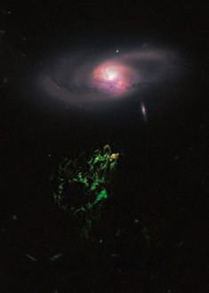 """Hanny's Voorwerp  Credit: NASA, ESA, W. Keel (Univ. Alabama), et al., Galaxy Zoo Team    Hanny's Voorwerp, Dutch for """"Hanny's Object"""", is enormous, about the size of our own Milky Way Galaxy. Glowing strongly in the greenish light produced by ionized oxygen atoms, the mysterious voorwerp is below spiral galaxy IC 2497 in this view from the Hubble Space Telescope. Both lie at a distance of some 650 million light-years in the faint constellation Leo Minor..."""