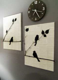 Pages from a book on canvas, real sticks, painted birds, black feathers.
