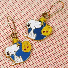 Dress up your favorite outfit with Snoopy and Woodstock earrings. Buy unused, vintage Aviva Peanuts earrings in our shop at CollectPeanuts.com.