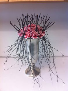 Chic Floral Designs, twig and carnation arrangement