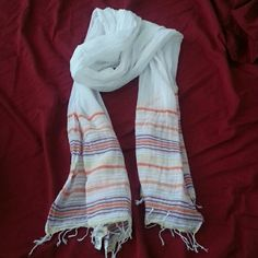 American Eagle lightweight scarf White American Eagle scarf. Has purple, orange, pink and yellow detailing around the bottom. Super lightweight.  Never used American Eagle Outfitters Accessories Scarves & Wraps