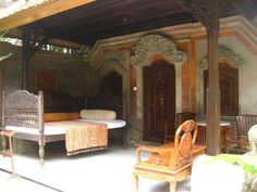 A simple arrangement of lounge furniture makes this porch and garden area quintessentially Balinese