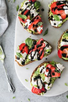 This Strawberry Caprese Avocado Toast with Burrata is the perfect light summer appetizer, and only requires 6 ingredients! The combination of fresh strawberries, mashed avocado, creamy burrata cheese, and sweet balsamic glaze is absolutely to die for! The addition of fresh basil and sea salt puts it over the top!