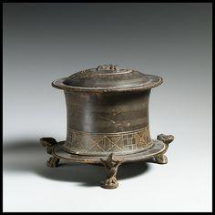 Terracotta pyxis (cosmetic box) Period: Hellenistic Date: 3rd–2nd century B.C. Culture: Greek, Macedonian Medium: Terracotta; west slope