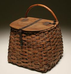 Wonderful large fishing creel; hand woven willow with bentwood frame handle, solid wood top with hand forged metal hinges and metal strap closure