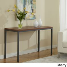 This modern console table by Jesper Office has a beautiful and durable wood finished top. With the clean lines and eye-catching design, there is no doubt you will marvel at the way this piece blends in with the rest of your living space.