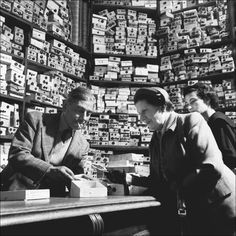 Women shop for buttons in London, 1953