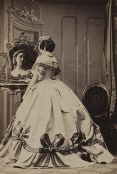 c1862. Photo by Camille Silvy, self portrait? Note spiral lacing to bodice. Getty Images. [jrb]