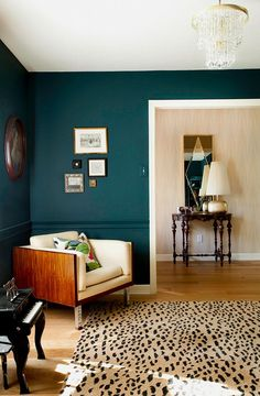 This dark teal compliments the warm tones in the floor, furniture an rug perfectly!