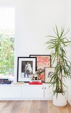 Leaning artwork in living space with indoor plant