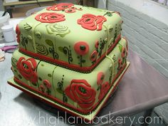 Soft red and green vintage fabric pattern cake with fondant cutouts and hand painting.