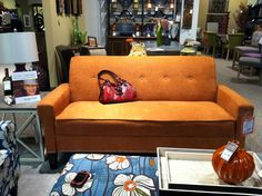 Orange Couch Hom Lakeville
