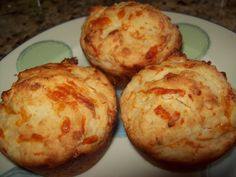 Jim n Nicks Cheese Biscuits! My husband came up with the recipe, and they honestly tasted better than the ones at Jim n Nicks! 1 cup Bisquick, 1 cup sour cream, 1/2 cup sugar, Shredded Cheddar cheese to taste. Mix all the ingredients together and pour into muffin tin. Bake 30 min or until golden brown. Enjoy!!