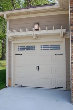 Love this pergola/trellis above the garage door.