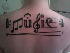Cool Music Tattoo On Upperback